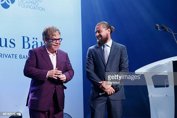 Elton John and Leonardo DiCaprio speak onstage at a Dinner and Auction during The Leonardo DiCaprio Foundation 2nd Annual SaintTropez Gala at Domaine...