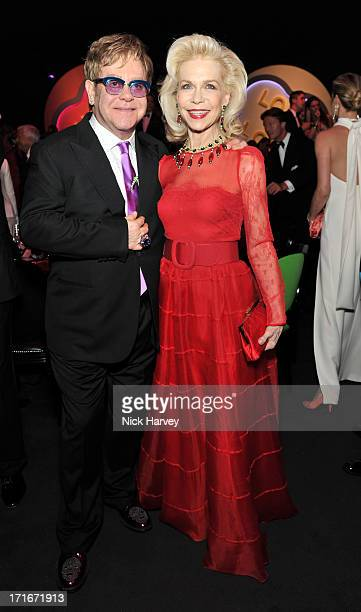 Elton John and Lynn Wyatt attend the 15th Annual White Tie and Tiara Ball to Benefit Elton John AIDS Foundation in Association with Chopard at Woodside on June 27, 2013 in Windsor, England. No sales to online/digital media worldwide until the 14th of July. No sales before July 14th, 2013 in UK, Spain, Switzerland, Mexico, Dubai, Russia, Serbia, Bulgaria, Turkey, Argentina, Chile, Peru, Ecuador, Colombia, Venezuela, Puerto Rico, Dominican Republic, Greece, Canada, Thailand, Indonesia, Morocco, Malaysia, India, Pakistan, Nigeria. All pictures are for editorial use only and mention of 'Chopard' and 'The Elton John Aids Foundation' are compulsory. No sales ever to Ok, Now, Closer, Reveal, Heat, Look or Grazia magazines in the United Kingdom. No sales ever to any jewellers or watchmakers other than Chopard.