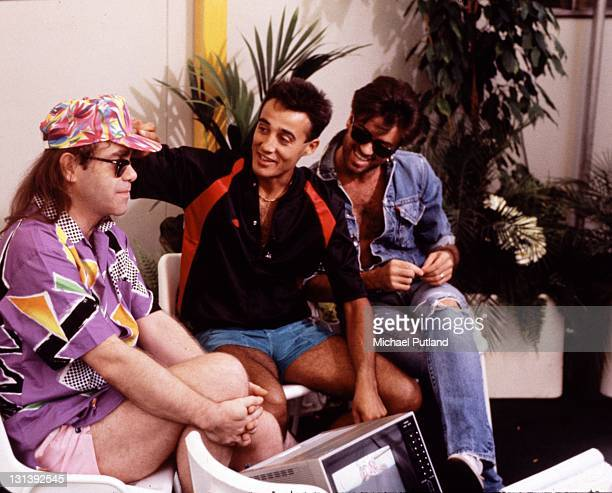 Elton John backstage with Andrew Ridgeley and George Michael of Wham at their 'The Final Concert' Wembley Stadium London 28th June 1986