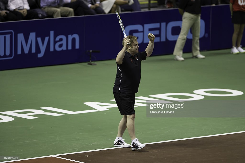 <a gi-track='captionPersonalityLinkClicked' href=/galleries/search?phrase=Elton+John&family=editorial&specificpeople=171369 ng-click='$event.stopPropagation()'>Elton John</a> celebrates during the exhibition doubles match against Venus Williams and Marion Bartoli during the 2013 Mylan WTT Smash Hits on November 17, 2013 at the ESPN Wide World of Sports Complex in Lake Buena Vista, Florida.
