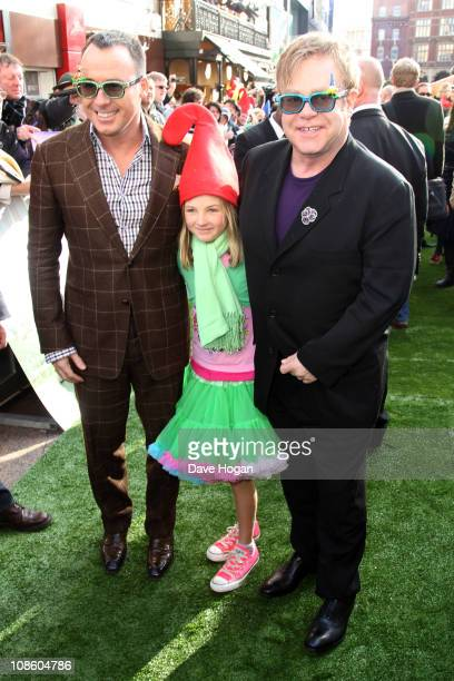 Elton John David Furnish and Esme Bertlesen attend the UK premiere of Gnomeo And Juliet held at the Odeon Leicester Square on January 30 2011 in...