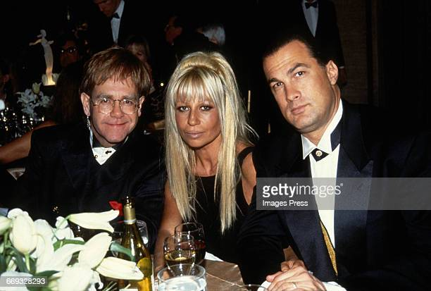 Elton John Donatella Versace and Steven Seagal attend the 12th Annual Council of Fashion Designers of America Awards at Lincoln Center circa 1993 in...