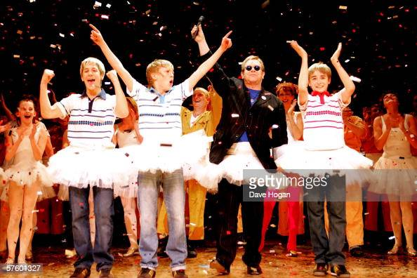 Elton John joins the cast of 'Billy Elliot the Musical' James Lomas George Maguire and Liam Mowerat on stage at Victoria Palace Theatre to celebrate...