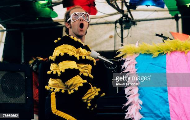 Elton John performs at an openair concert in May 1974 in Watford England