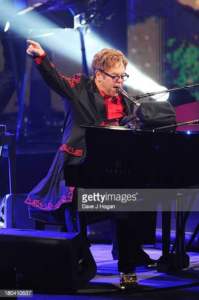 Elton John performs at day 12 of the iTunes Festival 2013 at The Camden Roundhouse on September 12 2013 in London England