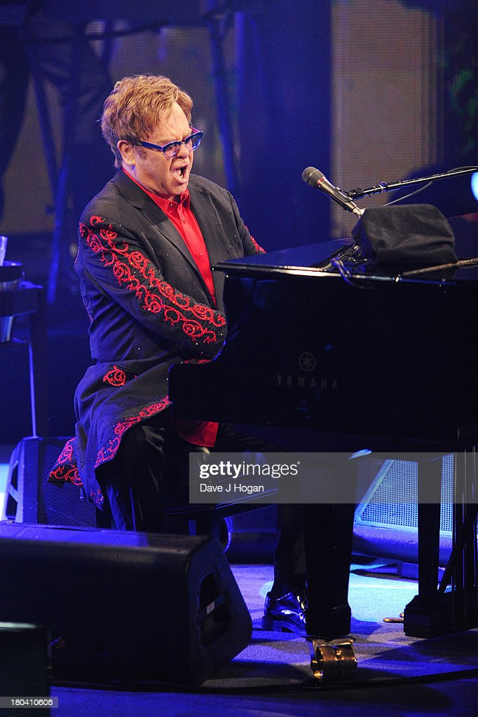 Elton John performs at day 12 of the iTunes Festival 2013 at The Camden Roundhouse on September 12, 2013 in London, England.