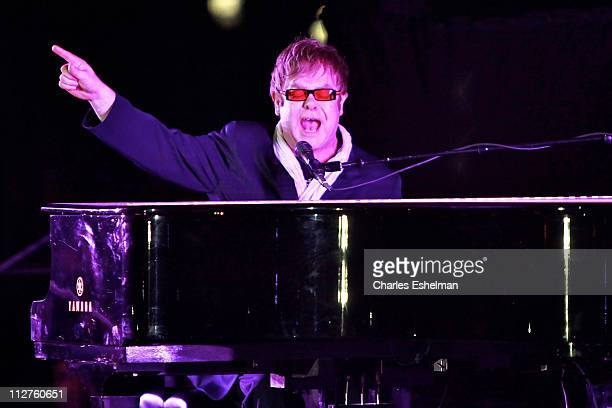 Elton John performs at the opening night performance at 'The Union' premiere during the 10th annual Tribeca Film Festival at North Cove at World...