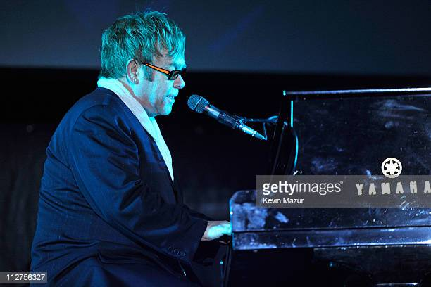 Elton John performs during the opening night performance at 'The Union' premiere during the 10th annual Tribeca Film Festival at North Cove at World...