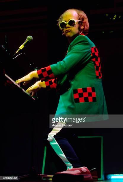 Elton John performs in concert circa 1975 in London England