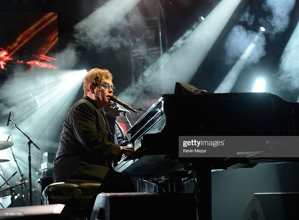 <a gi-track='captionPersonalityLinkClicked' href=/galleries/search?phrase=Elton+John&family=editorial&specificpeople=171369 ng-click='$event.stopPropagation()'>Elton John</a> performs onstage at MusiCares Person Of The Year Honoring Bruce Springsteen at Los Angeles Convention Center on February 8, 2013 in Los Angeles, California.