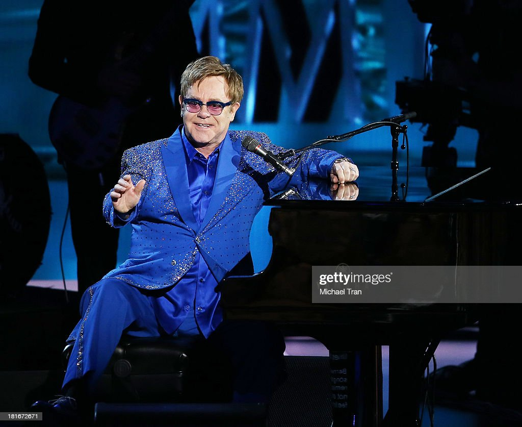 Elton John performs onstage during the 65th Annual Primetime Emmy Awards held at Nokia Theatre LA Live on September 22 2013 in Los Angeles California