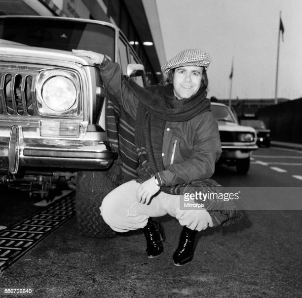 Elton John pictured next to an American Jeep at London Airport February 1979