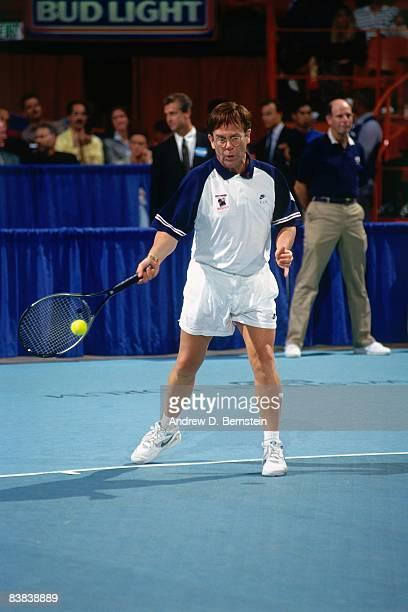 Elton John returns a shot during the Elton John Tennis Benefit on September 22 1993 at the Forum in Los Angeles California