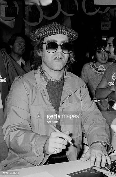 Elton John signing autographs circa 1970 New York