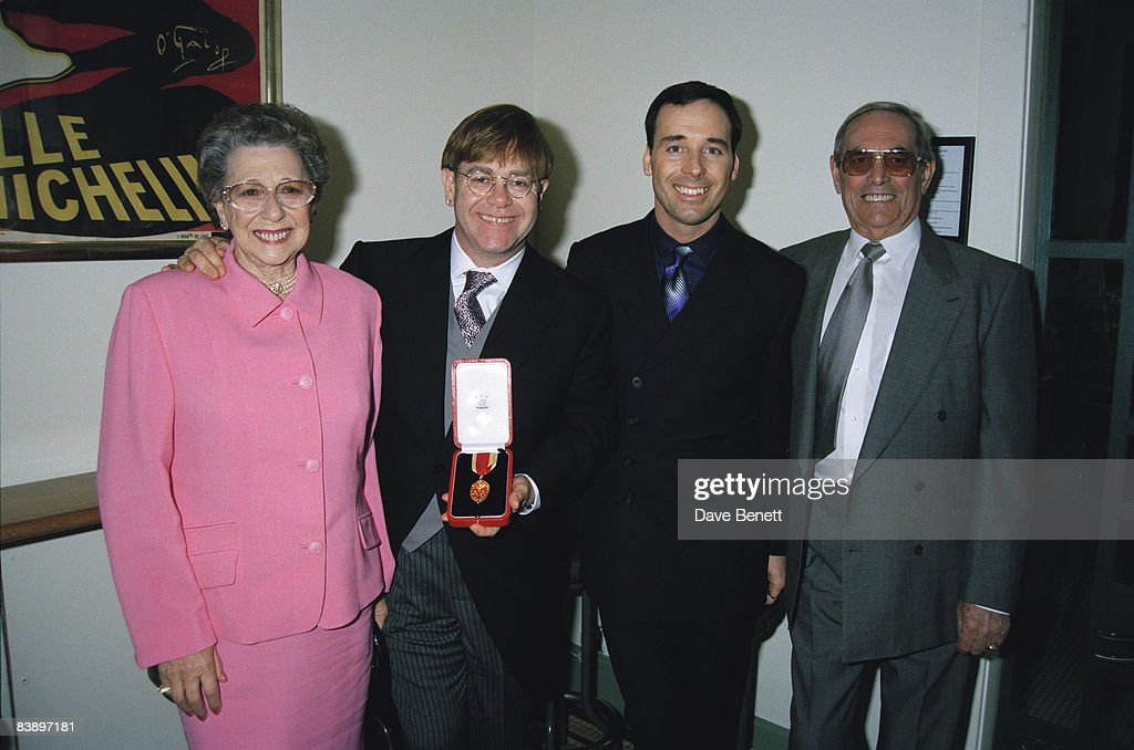 Elton John with his mother, his stepfather and his partner David Furnish, after receiving his knighthood in London, 24th February 1998.