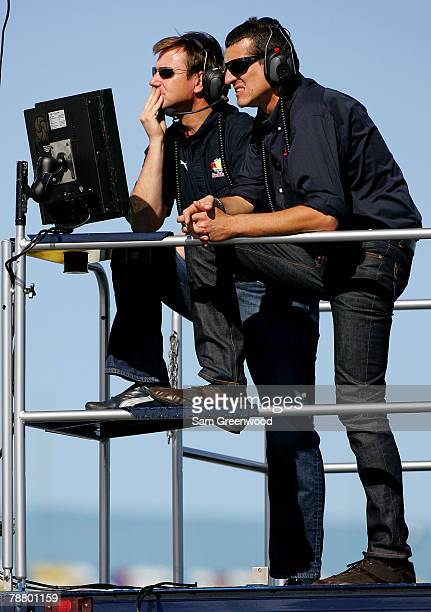 Elton Sawyer Competition Director for Red Bull Racing and Guenther Steiner VP of Competition for Red Bull Racing watch cars during NASCAR testing at...