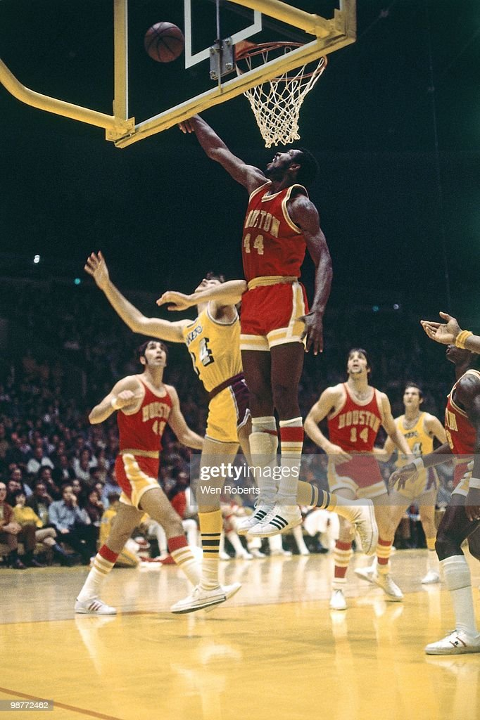 Elvin Hayes of the Atlanta Hawks blocks a shot attempt against the Los Angeles Lakers during a game played circa 1972 at the Great Western Forum in...