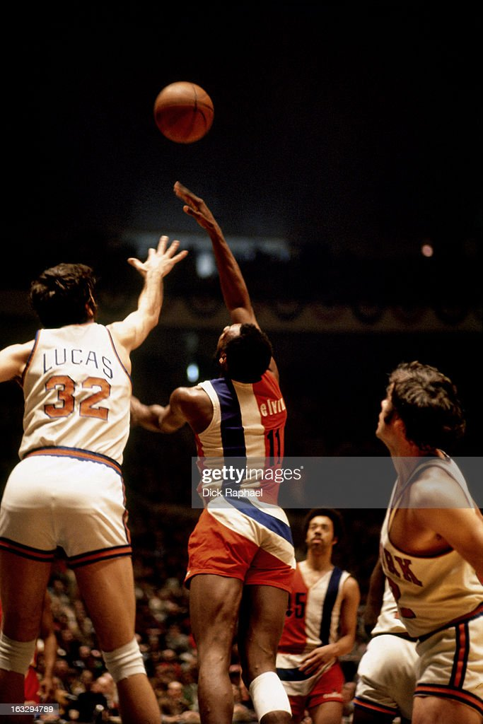 Elvin Hayes of the Baltimore Bullets shoots against Jerry Lucas of the New York Knicks circa 1973 at Madison Square Garden in New York City NOTE TO...