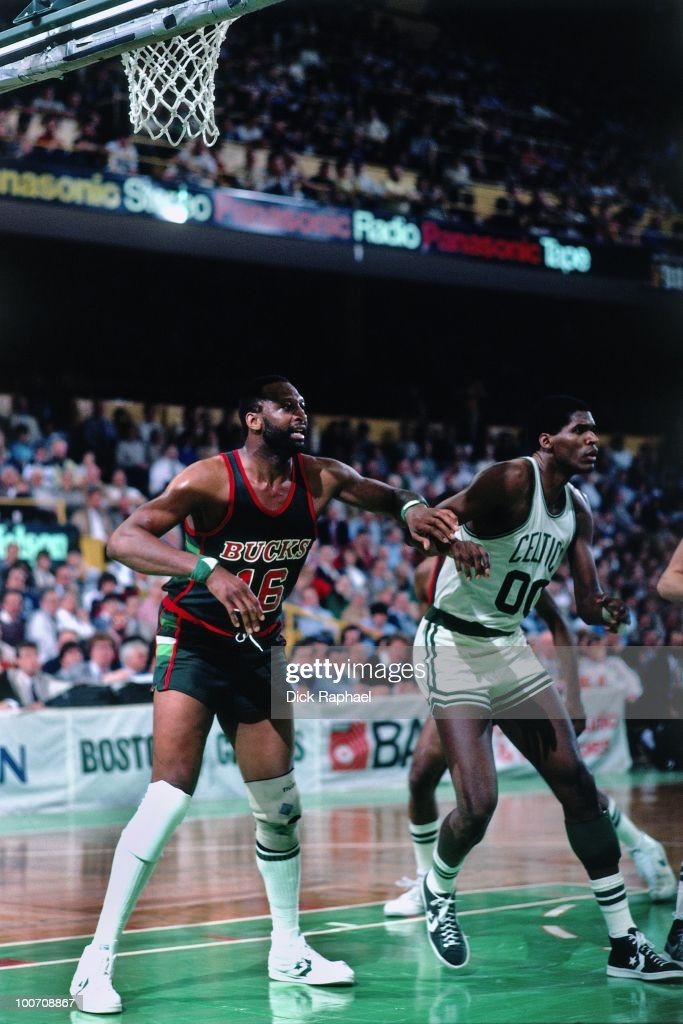 Elvin Hayes of the Milwaukee Bucks boxes out against Robert Parish of the Boston Celtics during a game played in 1984 at the Boston Garden in Boston...