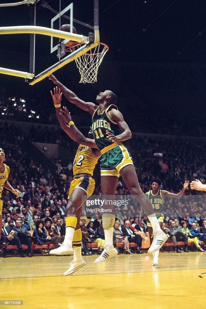Elvin Hayes of the San Diego Rockets blocks a shot attempt by the Los Angeles Lakers during a game played circa 1970 at the Great Western Forum in...