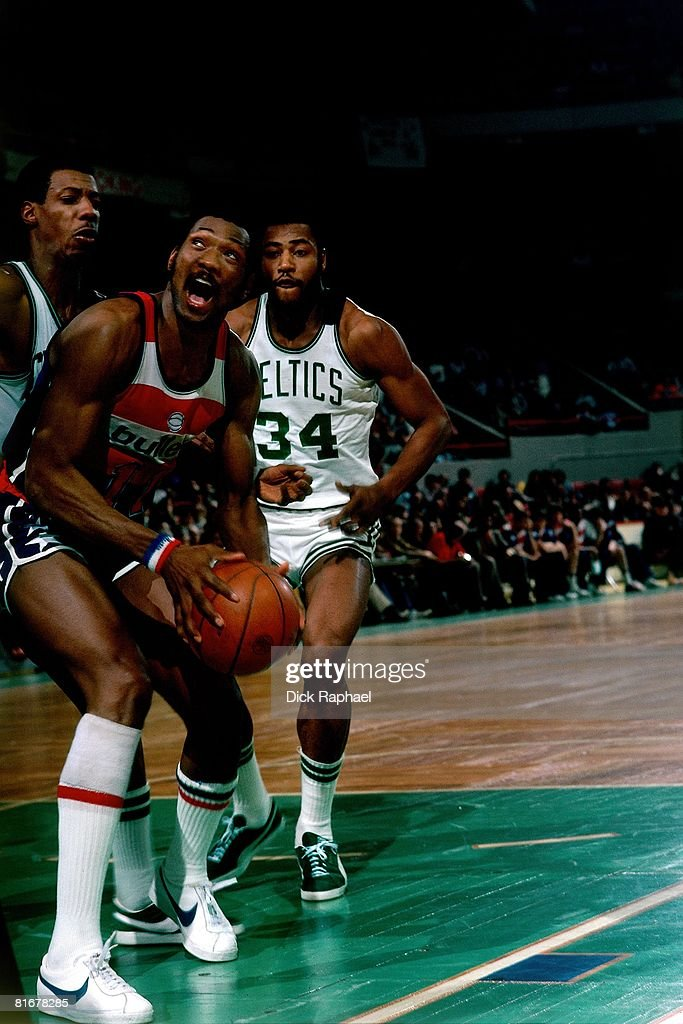 Elvin Hayes of the Washington Bullets posts up against Bob Bigelow of the Boston Celtics circa 1976 at the Boston Garden in Boston Massachusetts NOTE...