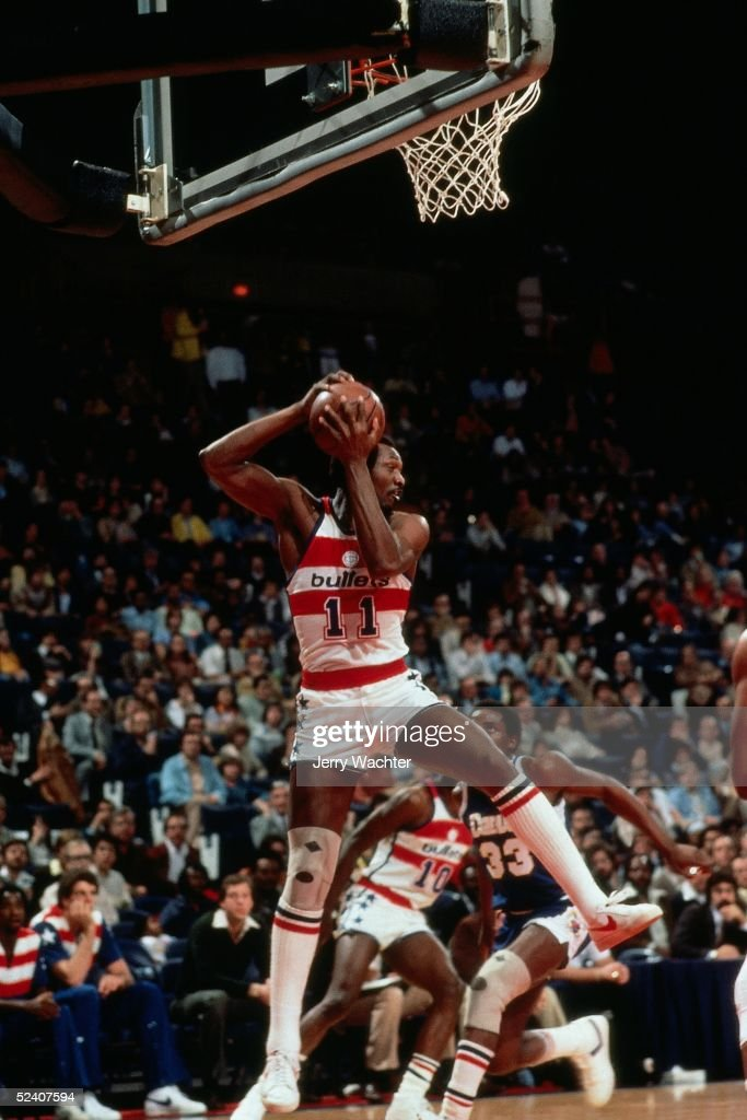 Elvin Hayes of the Washington Bullets rebounds against the Denver Nuggets circa 1981 at the Capital Centre in Washington DC NOTE TO USER User...