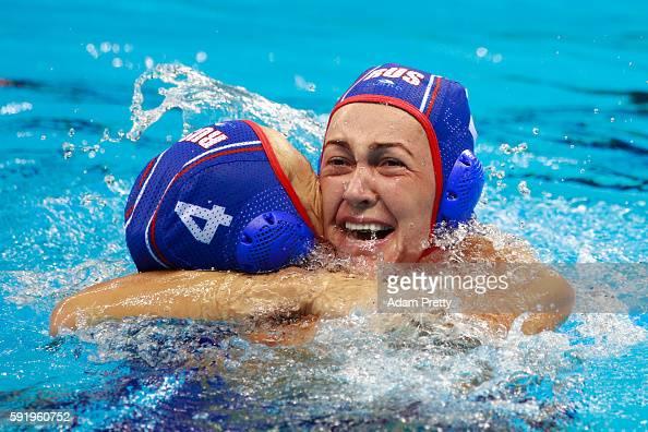 Elvina Karimova of Russia and Ekaterina Lisunova of Russia celebrate winning the bronze during the Women's Water Polo Bronze Medal match between...