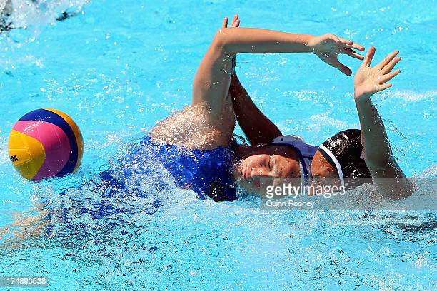 Elvina Karimova of Russia and Marina Radu of Canada compete for the ball during the Women's Water Polo quarterfinal match between Russia and Canada...