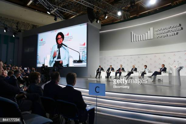 Elvira Nabiullina governor of Russia's central bank second right speaks during a panel session with left to right Guy Johnson anchor at Bloomberg...