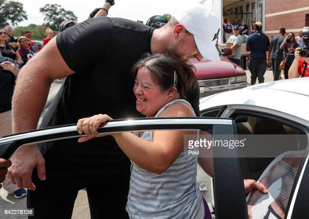 Elvira Vera jumps out of her car to embrace Houston Texans defensive end JJ Watt as he distributes relief supplies to people impacted by Hurricane...