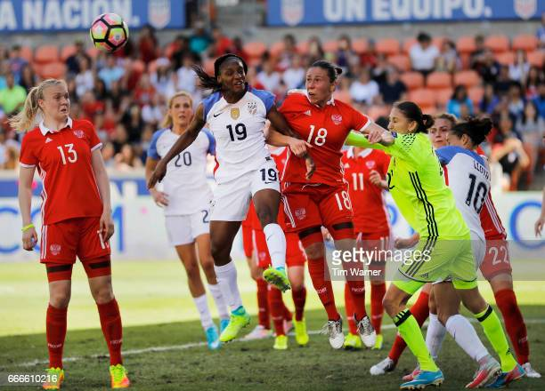 Elvira Ziiastinova of Russia heads the ball away from Crystal Dunn of US in the first half on a corner kick during the International Friendly soccer...