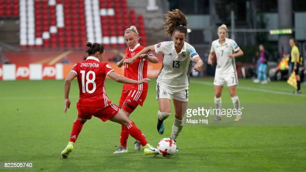 Elvira Ziyastinova of Russia and Ekaterina Sochneva of Russia attempt to tackle Sara Dabritz of Germany during the Group B match between Russia and...