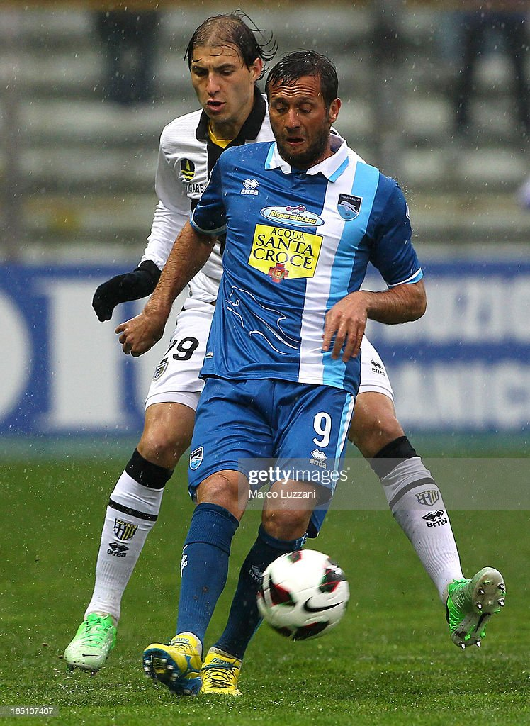 Elvis Abbruscato of Pescara Calcio competes for the ball with <a gi-track='captionPersonalityLinkClicked' href=/galleries/search?phrase=Gabriel+Paletta&family=editorial&specificpeople=747556 ng-click='$event.stopPropagation()'>Gabriel Paletta</a> of Parma FC during the Serie A match between Parma FC and Pescara at Stadio Ennio Tardini on March 30, 2013 in Parma, Italy.