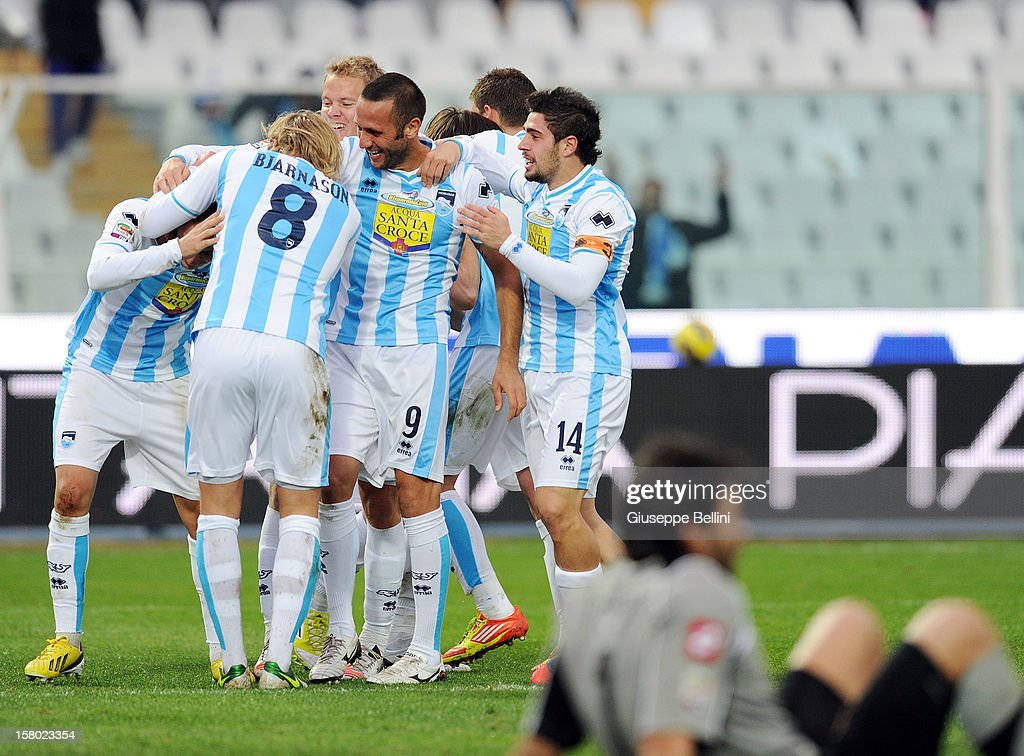 Elvis Abbruscato (C) of Pescara celebrates with his team-mates after scoring the opening goal during the Serie A match between Pescara and Genoa CFC at Adriatico Stadium on December 9, 2012 in Pescara, Italy.