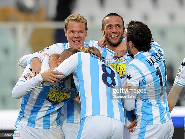 Elvis Abbruscato of Pescara celebrates with his teammates after scoring the opening goal during the Serie A match between Pescara and Genoa CFC at...