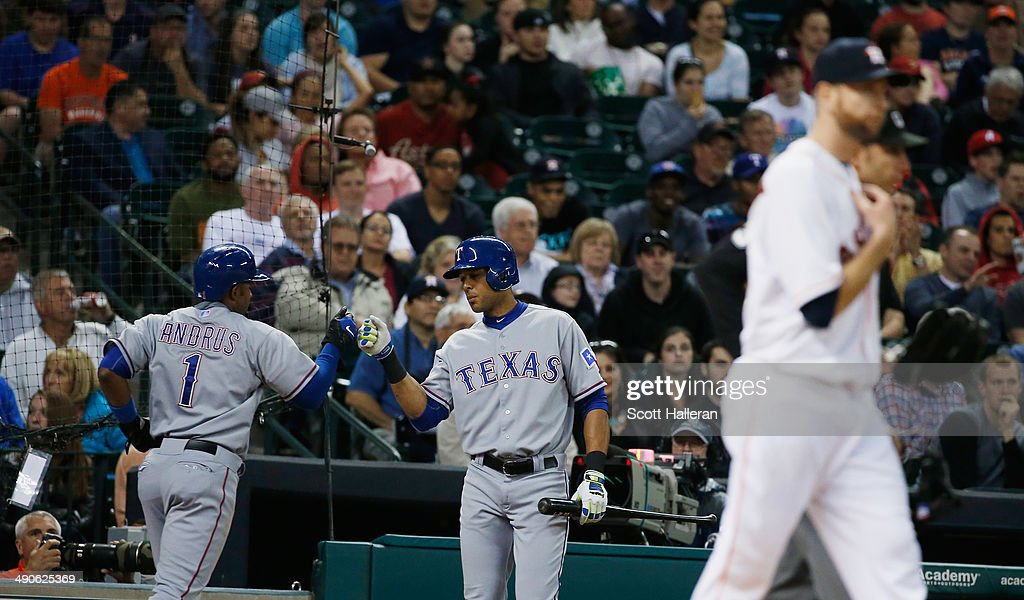 <a gi-track='captionPersonalityLinkClicked' href=/galleries/search?phrase=Elvis+Andrus&family=editorial&specificpeople=4845974 ng-click='$event.stopPropagation()'>Elvis Andrus</a> #1 and <a gi-track='captionPersonalityLinkClicked' href=/galleries/search?phrase=Alex+Rios&family=editorial&specificpeople=224676 ng-click='$event.stopPropagation()'>Alex Rios</a> #51 of the Texas Rangers celebrate after Andrus scored a runin the fifth inning of their game against the Houston Astros at Minute Maid Park on May 14, 2014 in Houston, Texas.