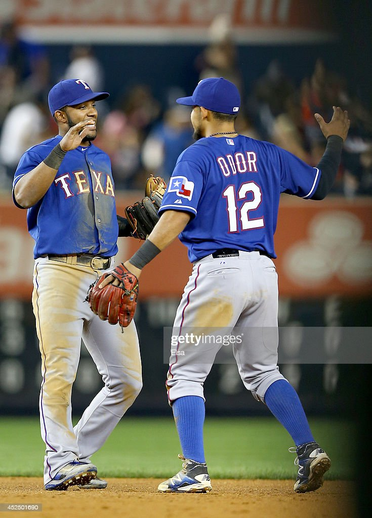 Elvis Andrus and Rougned Odor of the Texas Rangers celebrate the win over the New York Yankees on July 21 2014 at Yankee Stadium in the Bronx borough...