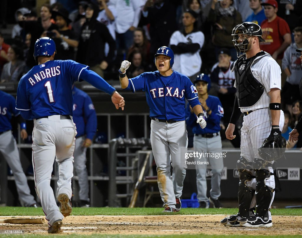 Elvis Andrus #1 of the Texas Rangers and Shin-Soo Choo #17 celebrate after scoring against the Chicago White Sox during the ninth inning on June 19, 2015 at U. S. Cellular Field in Chicago, Illinois. The Rangers defeated the White Sox 2-1.