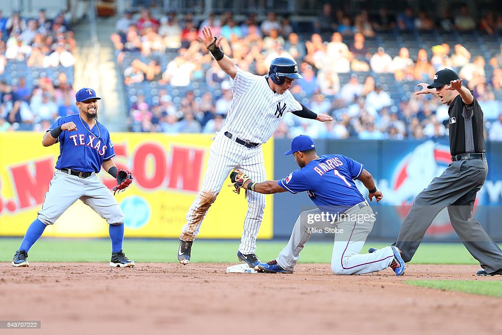 Elvis Andrus #1 of the Texas Rangers applies the tag late on a pick-off play on Jacoby Ellsbury #22 of the New York Yankees in the first inning at Yankee Stadium on June 29, 2016 in the Bronx borough of New York City.