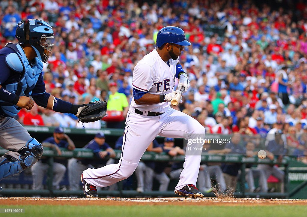 Elvis Andrus #1 of the Texas Rangers bunts against the Tampa Bay Rays at Rangers Ballpark in Arlington on April 9, 2013 in Arlington, Texas.