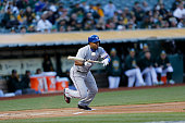 Elvis Andrus of the Texas Rangers bunts during the game against the Oakland Athletics at Oco Coliseum on April 8 2015 in Oakland California The...