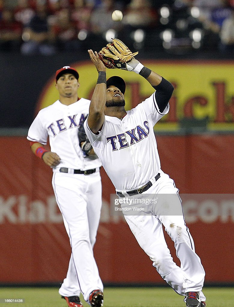 <a gi-track='captionPersonalityLinkClicked' href=/galleries/search?phrase=Elvis+Andrus&family=editorial&specificpeople=4845974 ng-click='$event.stopPropagation()'>Elvis Andrus</a> #1 of the Texas Rangers catches a fly ball hit by Chris Iannetta #17 of the Los Angeles Angels of Anaheim, not pictured, in the sixth inning of a baseball game at Rangers Ballpark in Arlington on April 7, 2013 in Arlington, Texas.