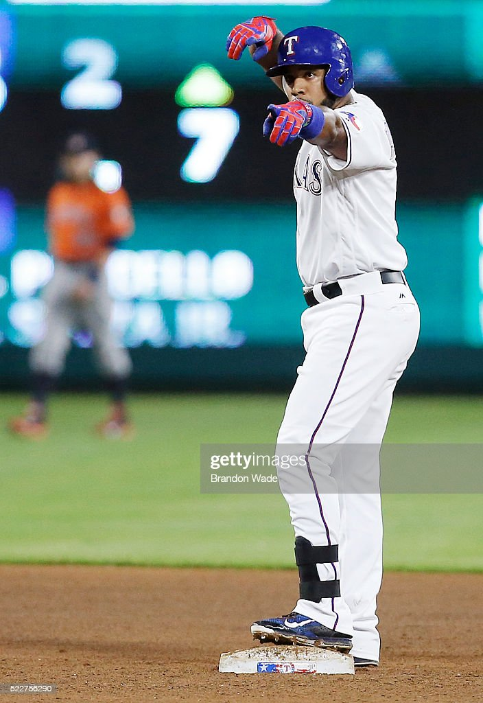 Elvis Andrus of the Texas Rangers celebrates a double during the fifth inning of a baseball game against the Houston Astros at Globe Life Park on...