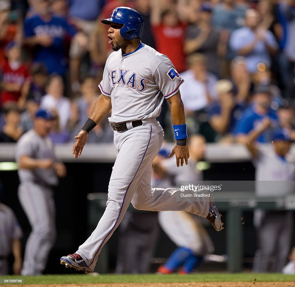 Elvis Andrus #1 of the Texas Rangers celebrates as he scores the winning run against the Colorado Rockies in the ninth inning of a game at Coors Field on August 8, 2016 in Denver, Colorado.