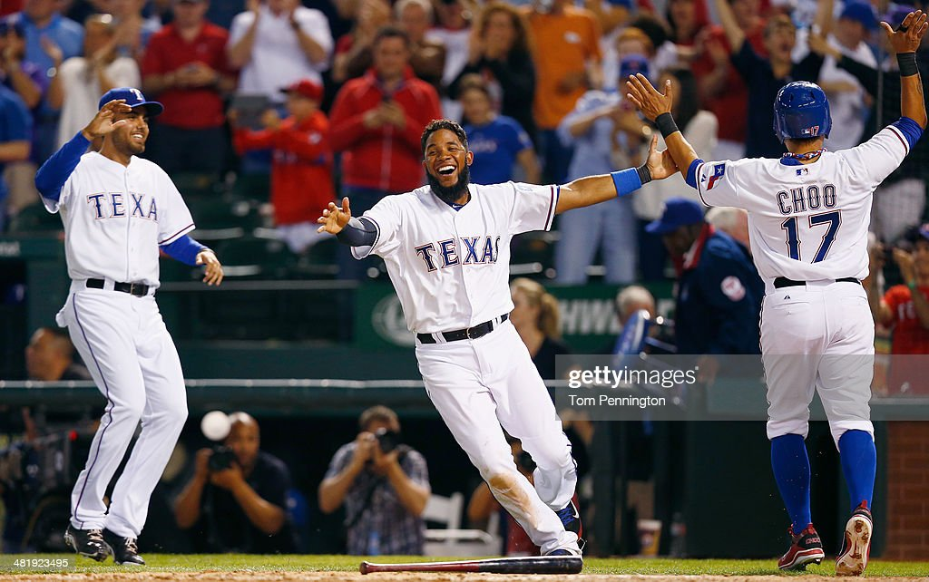 <a gi-track='captionPersonalityLinkClicked' href=/galleries/search?phrase=Elvis+Andrus&family=editorial&specificpeople=4845974 ng-click='$event.stopPropagation()'>Elvis Andrus</a> #1 of the Texas Rangers celebrates with <a gi-track='captionPersonalityLinkClicked' href=/galleries/search?phrase=Shin-Soo+Choo&family=editorial&specificpeople=196543 ng-click='$event.stopPropagation()'>Shin-Soo Choo</a> #17 of the Texas Rangers after Choo scored the game winning run against the Philadelphia Phillies in the bottom of the ninth inning at Globe Life Park in Arlington on April 1, 2014 in Arlington, Texas.