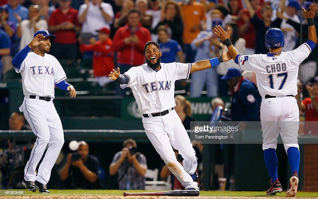 Elvis Andrus of the Texas Rangers celebrates with ShinSoo Choo of the Texas Rangers after Choo scored the game winning run against the Philadelphia...