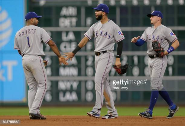 Elvis Andrus of the Texas Rangers congratulates Nomar Mazara and Ryan Rua after the final out against the Houston Astros at Minute Maid Park on June...