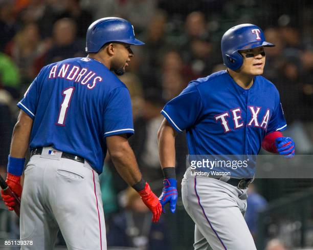 Elvis Andrus of the Texas Rangers congratulates ShinSoo Choo of the Texas Rangers after Choo hit a home run in the seventh inning against the Seattle...