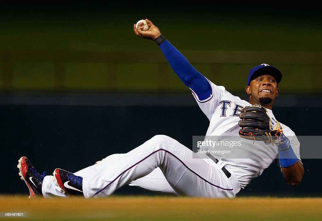 <a gi-track='captionPersonalityLinkClicked' href=/galleries/search?phrase=Elvis+Andrus&family=editorial&specificpeople=4845974 ng-click='$event.stopPropagation()'>Elvis Andrus</a> #1 of the Texas Rangers fields a an infield single hit by Adam Jones #10 of the Baltimore Orioles in the top of the seventh inning at Globe Life Park in Arlington on June 3, 2014 in Arlington, Texas.