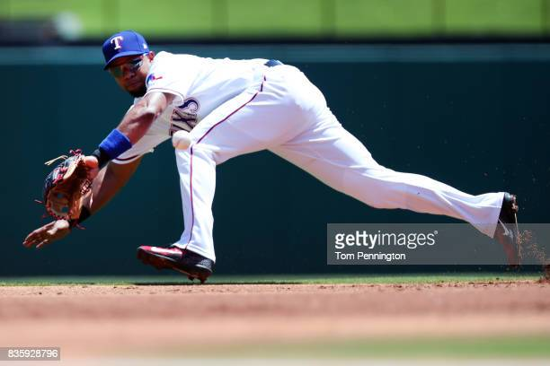 Elvis Andrus of the Texas Rangers fields a ground ball hit by Avisail Garcia of the Chicago White Sox in the top of the first inning at Globe Life...